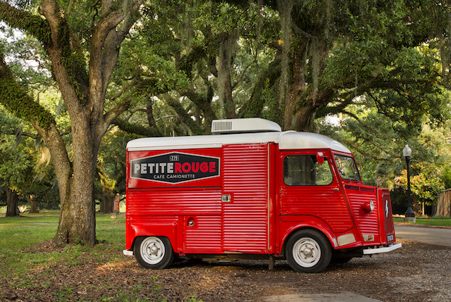 The Red Petite Rouge food truck sits underneath moss trees in Louisiana.